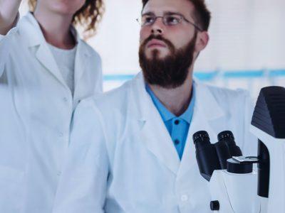students-observing-slide-in-laboratory.jpg